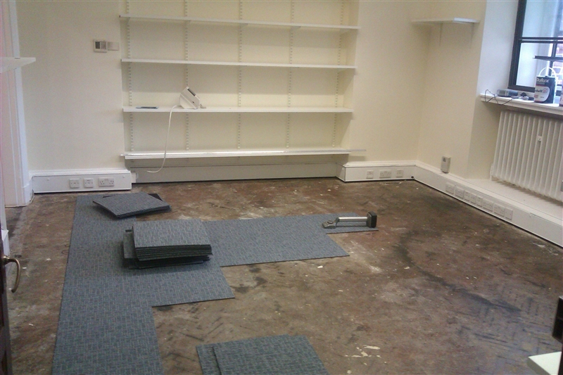 01 office carpet tile installation in progress