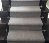 Bloomsbury 100 % wool carpet fitted with Jubilee Antique stairs rods and Black Herringbone tape to edges.