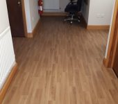 Polyflor Polysafe Wood FX European Oak vinyl flooring and JHS Urban Space Mixed Spice Carpet tiles fitted to offices.