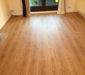 ELKA 8mm Rustic Oak Laminate Flooring supplied and installed to a living room.